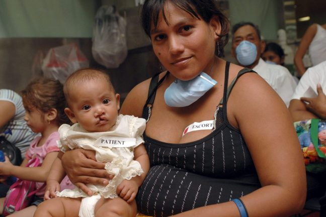 070719-N-7088A-003 PACIFIC OCEAN (July 19, 2007) - Sara Osego poses for a picture with her four-month-old baby after checking onto Military Sealift Command hospital ship USNS Comfort (T-AH 20) for cleft palette care. Operation Smile, a non-government organization, joined the crew of Comfort to perform cleft palette procedures while off the coast of Nicaragua. Comfort is on a four-month humanitarian deployment to Latin America and the Caribbean to provide medical treatment to patients in a dozen countries. While deployed, Comfort is under operational control of U.S. Naval Forces Southern Command and tactical control of Destroyer Squadron 24. U.S. Navy photo by Mass Communication Specialist 2nd Class Elizabeth Allen (RELEASED)