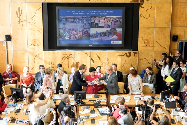 The report from the High Level Working Group on Health and Human Rights of Women, Children and Adolescents is handed over to WHO Director-General Margaret Chan at the 70th World Health Assembly May 22. Photo Courtesy WHO.