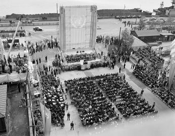 The cornerstone of the United Nations Permanent Headquarters, was laid on United Nations Day - 24 October - at a special open-air General Assembly meeting held on the site of the Headquarters building in Manhattan, New York. The ceremony, marking the Fourth Anniversary of the United Nations, was attended by President Harry S. Truman who was the principal speaker. Secretary-General Trygve Lie deposited in the stone copies of the United Nations Charter and the Universal Declaration of Human Rights. General view of ceremony. UN Photo 24 October 1949 United Nations, New York Photo # 117535